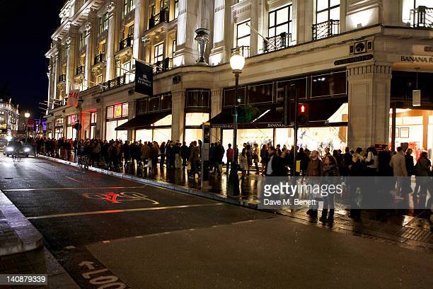 Shoppers line up outside at the launch of Italian fashion house Marni's collection for HM at HM Regent Street on March 7 2012 in London England