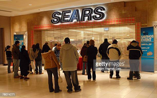 Shoppers line up outside Sears shortly before 5am at King of Prussia Mall November 23 2007 in King of Prussia Pennsylvania The mall opened at 5am for...