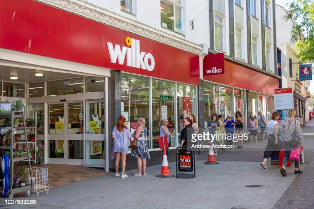 Shoppers line up waiting to enter Wilko in Folkestone town centre on the 15th of June 2020 the day the shops reopen for the first time in 3 months...
