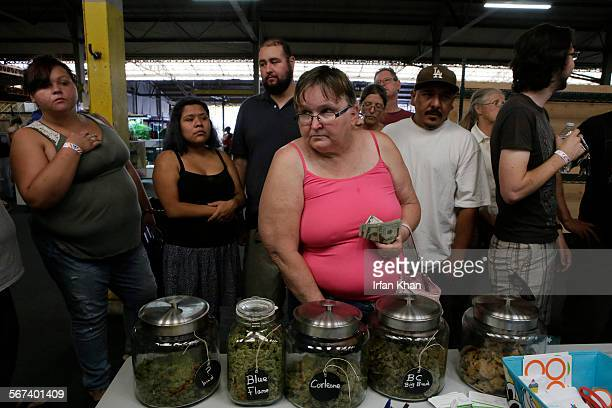 JULY 05 2014 Shoppers lined up at one of many pot vendors stall at cannabis farmers market organized by California Heritage Market at West Coast...