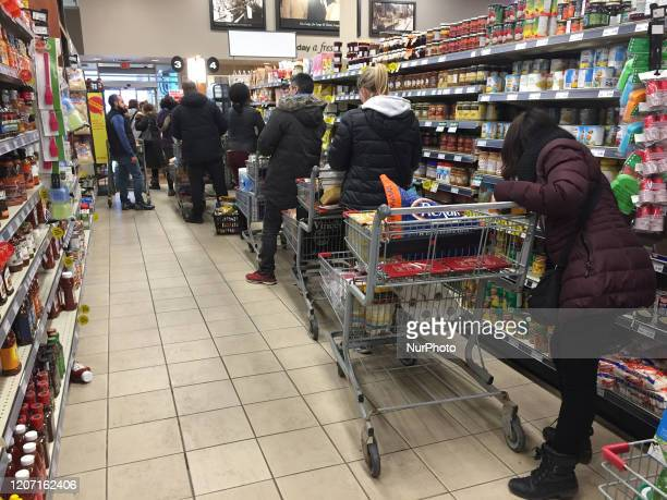 Shoppers linedup into the isles as grocery stores were packed with big crowds and long lines as latest spike of COVID19 cases prompted panic buying...