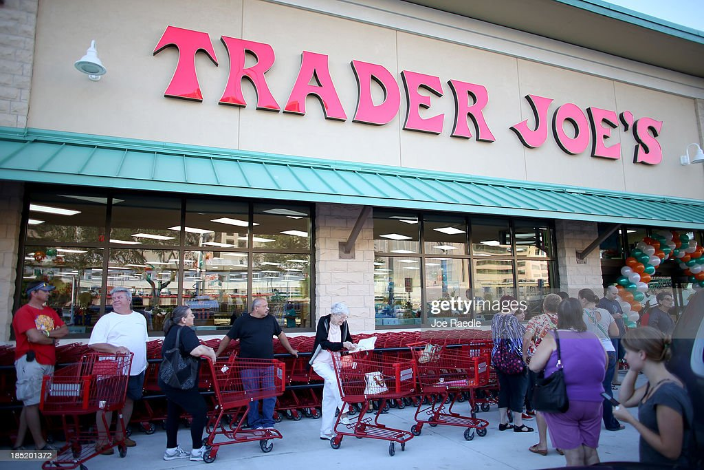 Shoppers lineup as they wait for the grand opening of a Trader Joe's on October 18, 2013 in Pinecrest, Florida. Trader Joe's opened its first store in South Florida where shoppers can now take advantage of the California grocery chains low-cost wines and unique items not found in other stores. About 80 percent of what they sell is under the Trader Joe's private label.