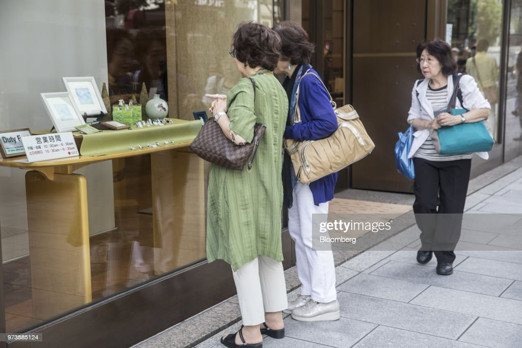 Shoppers look at a window display of a store in the Ginza district of Tokyo, Japan, on Friday, May 25, 2018. The savings-rich elderly spend about 9.7 trillion yen ($87 billion) a year on their offspring and such spending last year accounted for about a third of the modest growth in total consumption, according to Hiromichi Shirakawa, chief Japan economist at Credit Suisse Group. Photographer: Shiho Fukada/Bloomberg via Getty Images