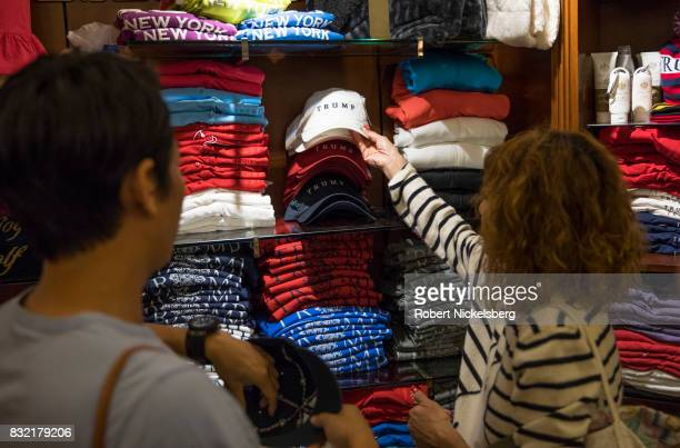 Shoppers look at hats at the Trump gift store inside of Trump Tower August 14 2017 in New York City Security throughout the area is high as President...