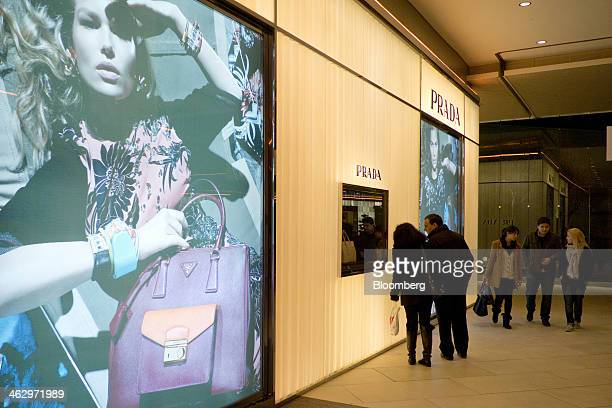 Shoppers look at the window display of a Prada SpA luxury clothing store in the Zorlu shopping mall in Istanbul Istanbul Turkey on Wednesday Jan 15...