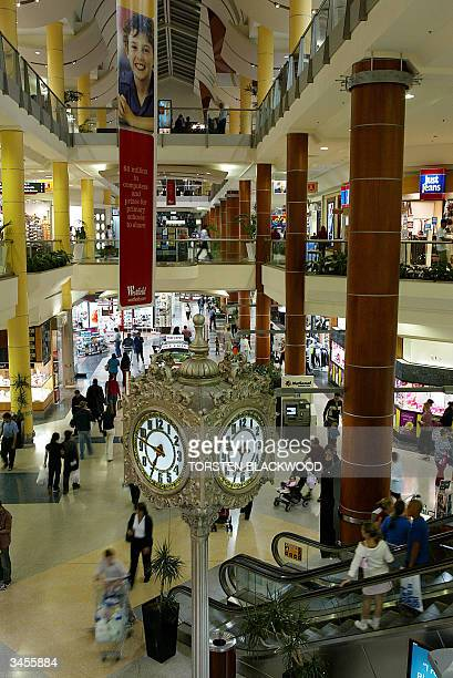 Shoppers look for bargains at the giant Westfield retail complex at Eastgardens in Sydney 22 April 2004 as the company announces that it would merge...