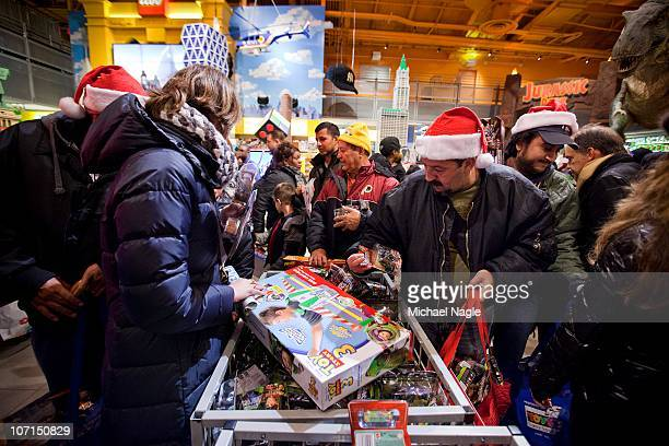 Shoppers look for bargains at Toys'R'Us on Thanksgiving Day November 25 in New York City The stores which opened nationwide at 10PM will remain open...