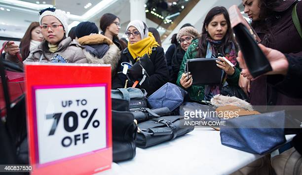Shoppers look for bargains in Selfridges department store in central London during the first hour of business on December 26 in the post Christmas...