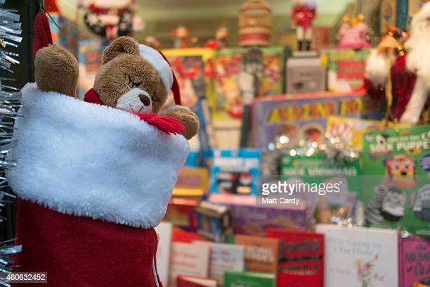 Shoppers look for Christmas gifts on the high street on December 18 2014 in Bath England With less than a week until Christmas traditional high...