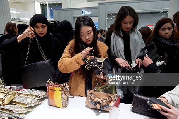 Shoppers look for discounted handbags in Selfridges department store in central London on December 26 in the postChristmas Boxing Day sales AFP PHOTO...