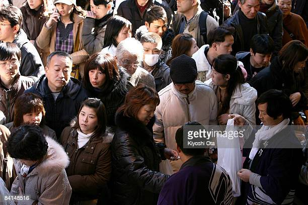 Shoppers look for fresh food at the Ameya Yokocho street market on December 31 2008 in Tokyo Japan People shop around in preparation to celebrate the...