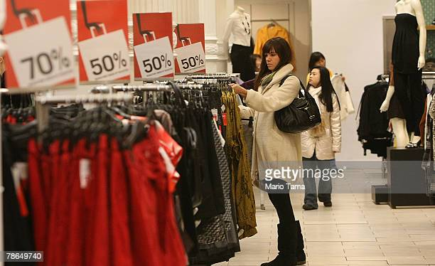 Shoppers look for sale items in an H M store December 26 2007 in New York City Deep discounts were being offered nationwide by retailers on the day...