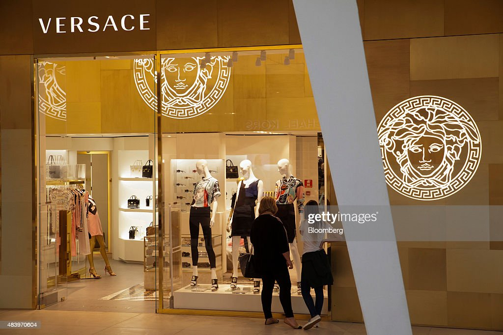 Shoppers Look In The Window Of The Gianni Versace SpA Store At The Village  Mall In