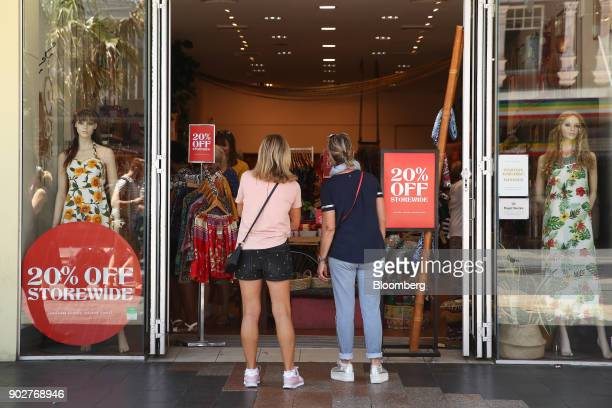Shoppers look inside a clothing store in the Manly Corso retail area in Sydney Australia on Friday Jan 5 2018 The Australian Bureau of Statistics is...
