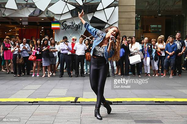 Shoppers look on as Prinnie Stevens performs during a Michael Jackson 'Moonwalking' demonstration at Pitt St Mall on February 24 2015 in Sydney...