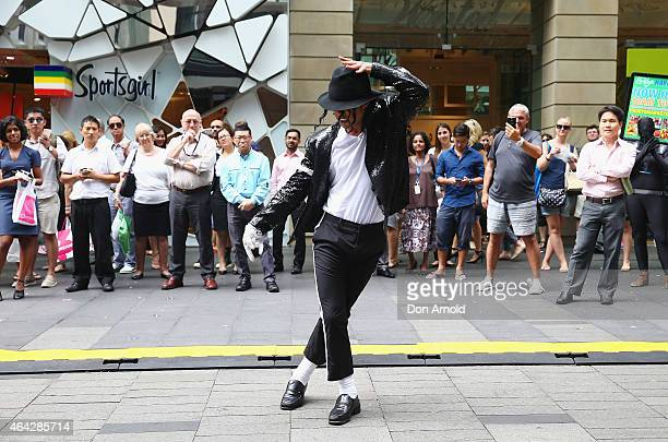 Shoppers look on as Sean Christopher performs during a Michael Jackson 'Moonwalking' demonstration at Pitt St Mall on February 24 2015 in Sydney...