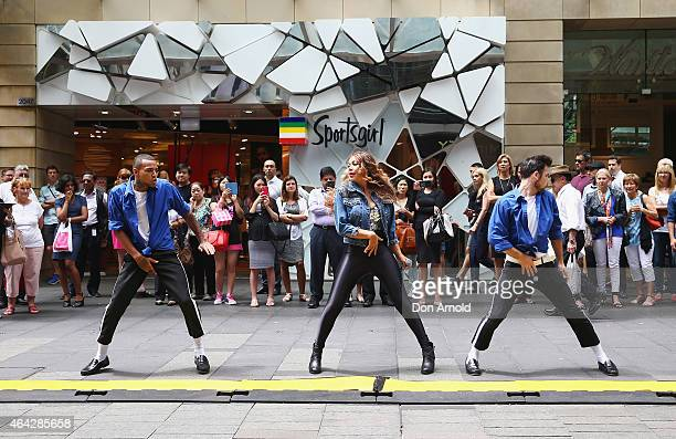 Shoppers look on as Simeon Henri Prinnie Stevens and Joe Drum perform during a Michael Jackson 'Moonwalking' demonstration at Pitt St Mall on...