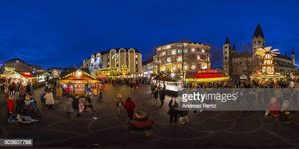 Shoppers look round the Christmas Market at the Muensterplatz on December 22 2015 in BonnGermany