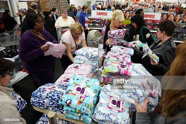 Shoppers look through items at a Kmart on Thanksgiving night November 22 2012 in Griffith Indiana City Many stores got a head start on the...