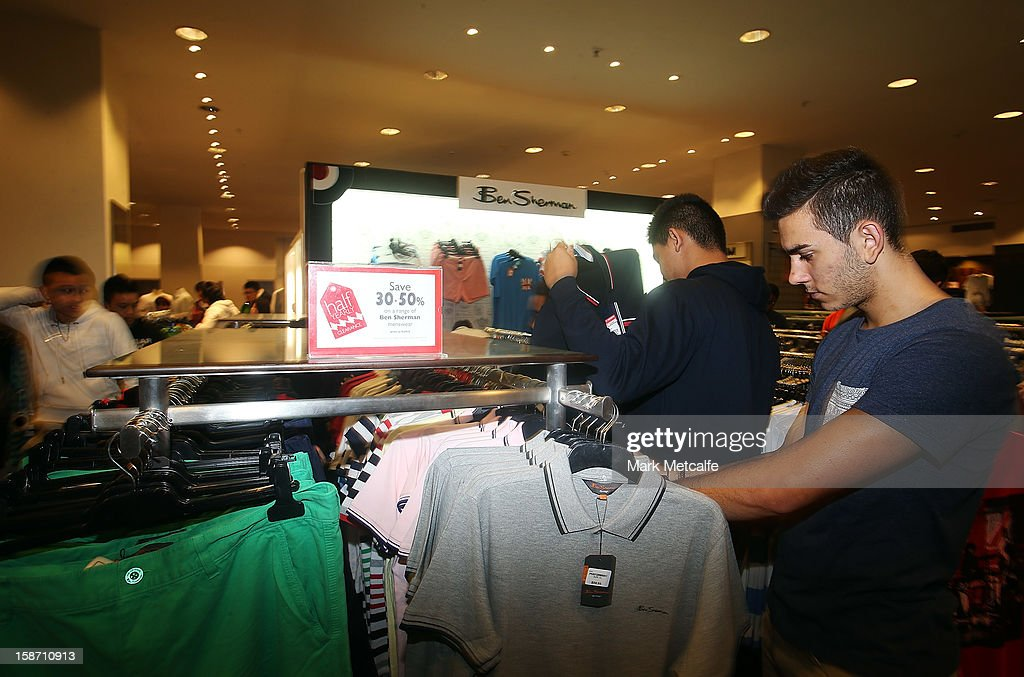 Shoppers look through racks of sale items during the Boxing Day sales at the David Jones Market Street store on December 26, 2012 in Sydney, Australia. Boxing Day proves to be one of the busiest days for retail outlets in Sydney with thousands flocking to post-Christmas sales.