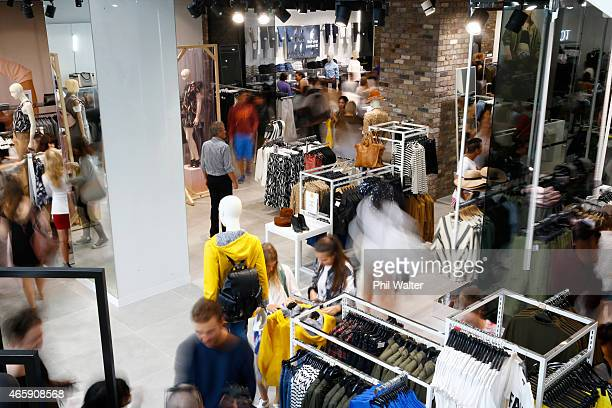 Shoppers look through the display racks of clothes on the opening day of New Zealand's first TopShop and TopMan store on Queen Street on March 12,...