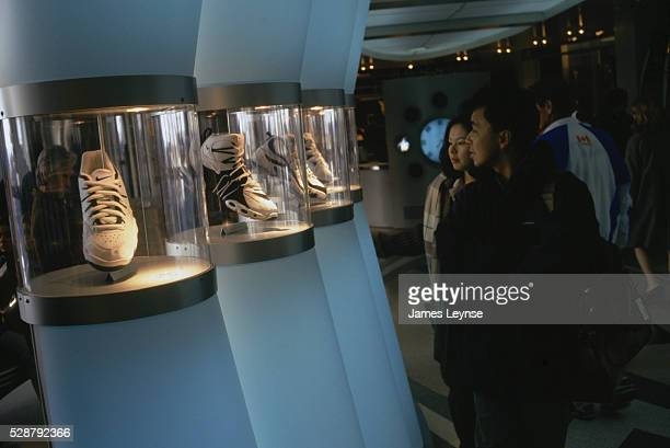 Shoppers Looking at Niketown Shoe Display