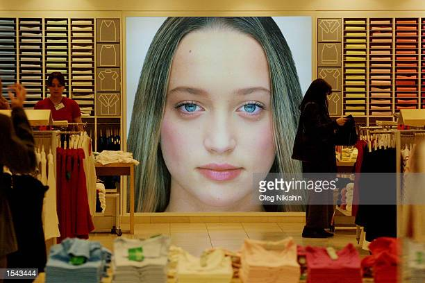 Shoppers looks through clothes at a Benetton store May 17 2002 in downtown Moscow US President George W Bush will visit Russia as part of a trip...