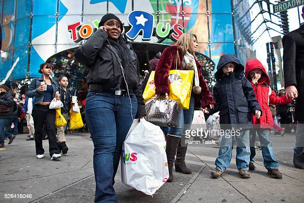 Shoppers make last minute Christmas purchases in Toys 'R' Us flagship store in Times Square in New York City, on Friday, December 23, 2011.