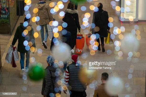Shoppers make their last minute purchases on Christmas Eve on December 24 2018 in Birmingham England Financial management consultancy Deloitte has...