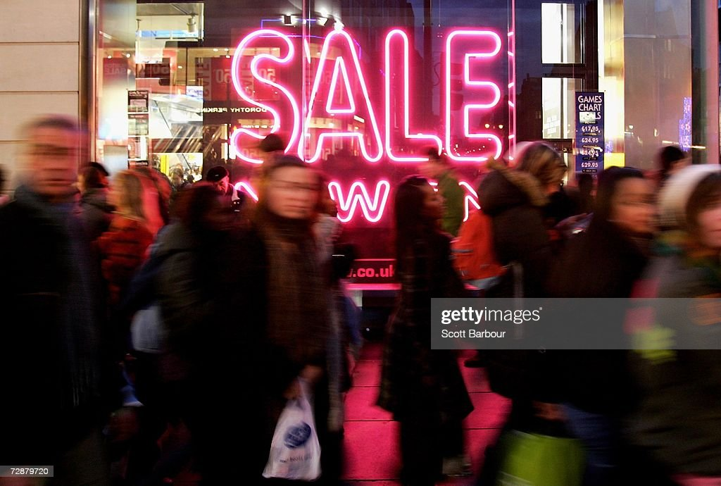 Shoppers make their way along Oxford Street on December 27, 2006 in London, England. With many stores open for the first time since Christmas Eve, bargain hunters are searching for the best buys as the post-Christmas sales get under way.