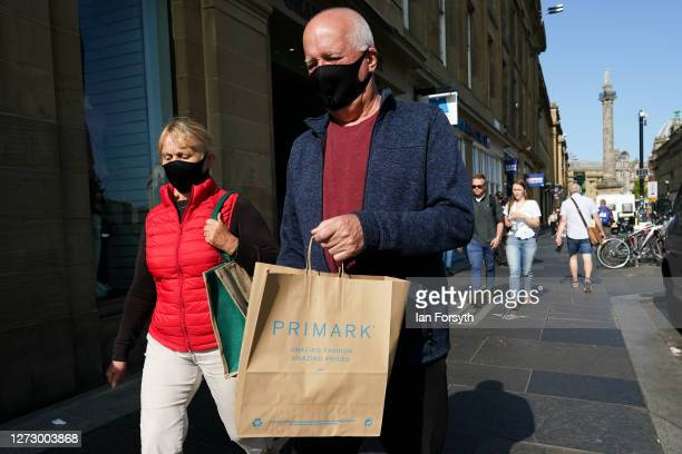 Shoppers make their way through Newcastle city centre on September 17 2020 in Newcastle upon Tyne England Almost two million people in northeast...