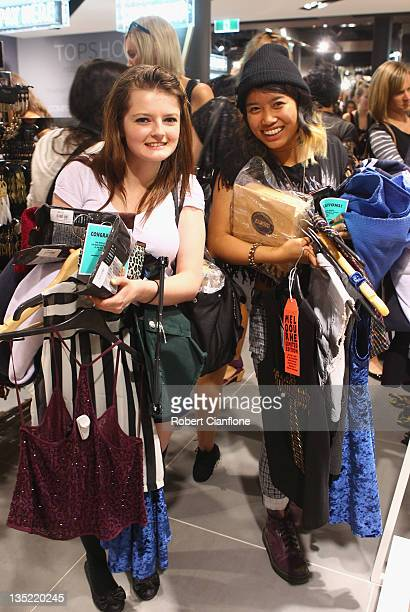 Shoppers make their way through the isles at the public opening of Australia's first TopshopTopman retail location Australia in South Yarra on...