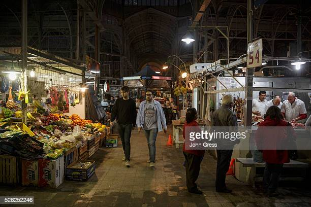 Shoppers make their way through the1890's built Mercado de San Telmo in Buenos Aires Argentina September 18 2015