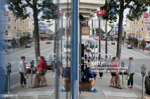 Shoppers make their way up Columbus Avenue in the North Beach neighborhood of San Francisco, Calif. Thursday, Saturday, May 10, 2019.