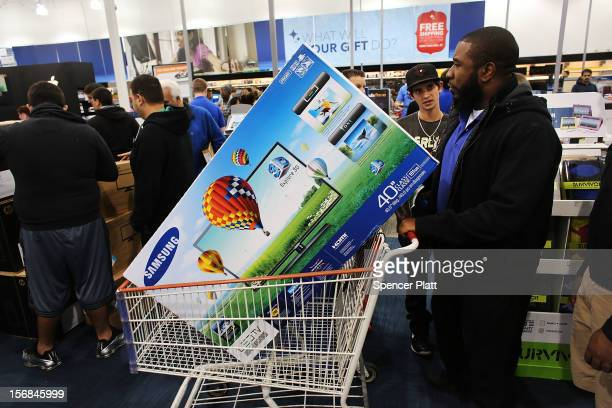 Shoppers move through a Best Buy store on November 23 2012 in Naples Florida Although controversial many big retail stores have again decided to get...