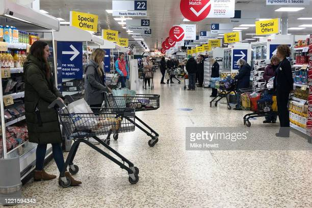 Shoppers observe a minute's silence in Tescos on April 28th 2020 in Shoreham United Kingdom The moment of silence commemorating the key workers who...