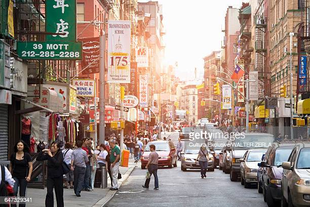 Shoppers on busy street, Chinatown, Manhattan, New York, USA