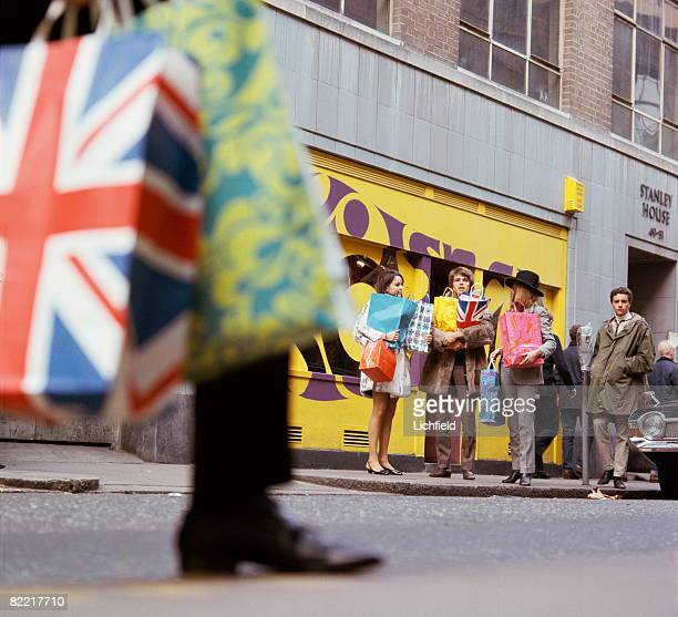 Shoppers on Carnaby Street in Soho West London 24th October 1967 The area is famous for its independent fashion boutiques and designers synonymous...