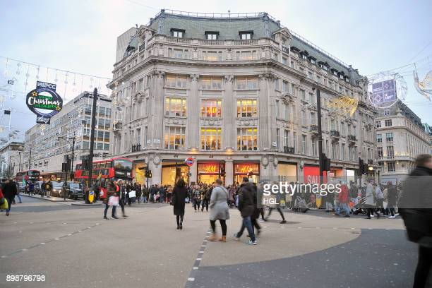 Shoppers on Oxford Street hit the Boxing Day Sales on December 26 2017 in London England According to reports a decrease for instore shopping is...