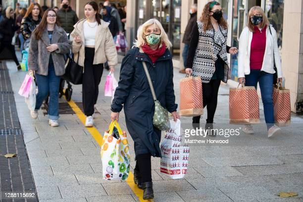 Shoppers on Queen Street on Black Friday on November 27, 2020 in Cardiff, Wales. Restrictions across Wales have been relaxed following a two-week...
