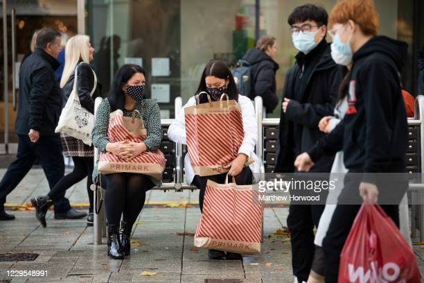 Shoppers on Queen Street with bags from Primark on November 9, 2020 in Cardiff, Wales. Wales' health minister said cases are levelling off after its...