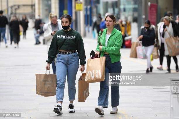 Shoppers on the Hayes as non-essential retail reopens on April 12, 2021 in Cardiff, Wales. Lockdown restrictions have been eased further today with...