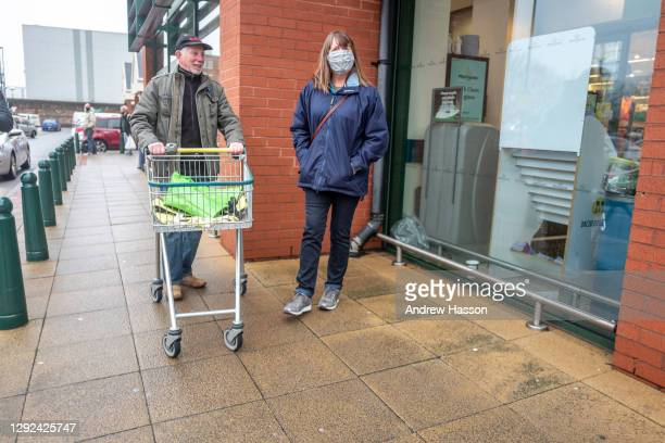 Shoppers outside a branch of Morrisons on December 21, 2020 in Portsmouth, United Kingdom. A new strain of the Covid-19 virus has led to France...