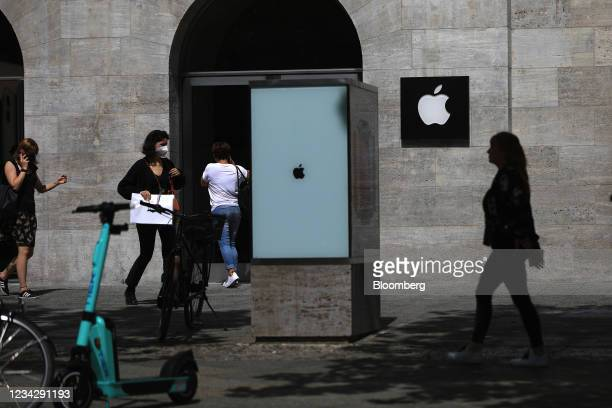 Shoppers outside the Apple Inc. Store in Berlin, Germany, on Thursday, July 29, 2021. Germany reports gross domestic product figures on July 30....