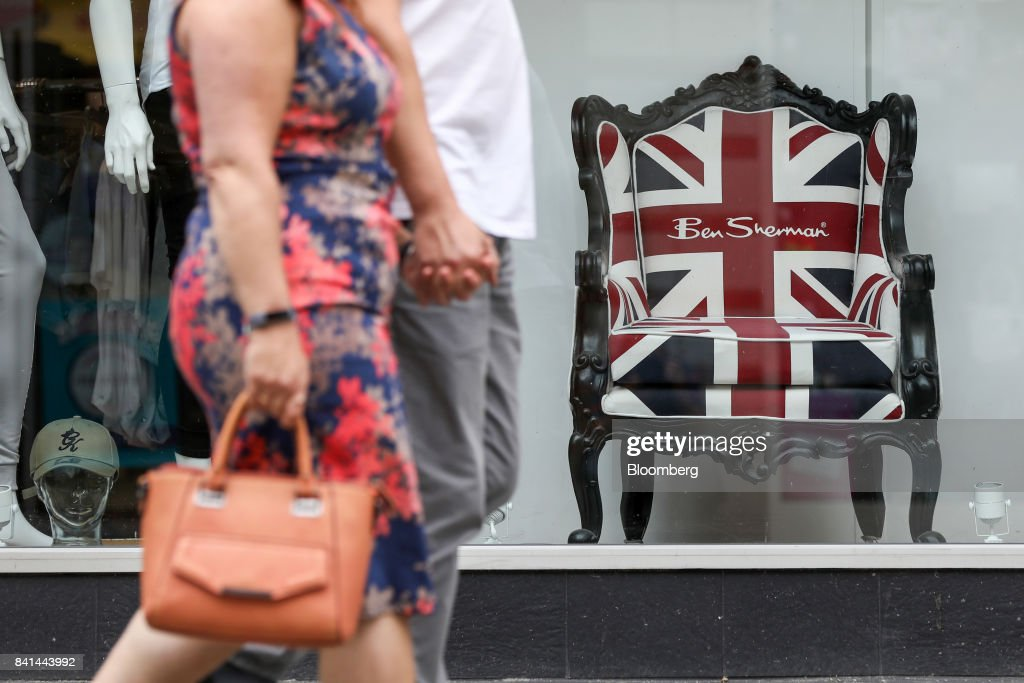 Shoppers pass a Ben Sherman Union Flag also known as a Union Jack branded chair in & Jack Sherman Stock Photos and Pictures | Getty Images