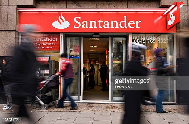 Shoppers pass a branch of the newlybranded Santander bank on Oxford Street in central London on January 11 2010 Spanish banking giant Santander on...