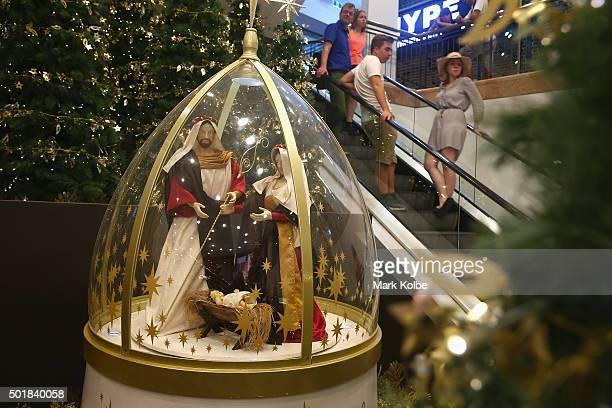 Shoppers pass a nativity scene in Pitt Street mall on December 18 2015 in Sydney Australia