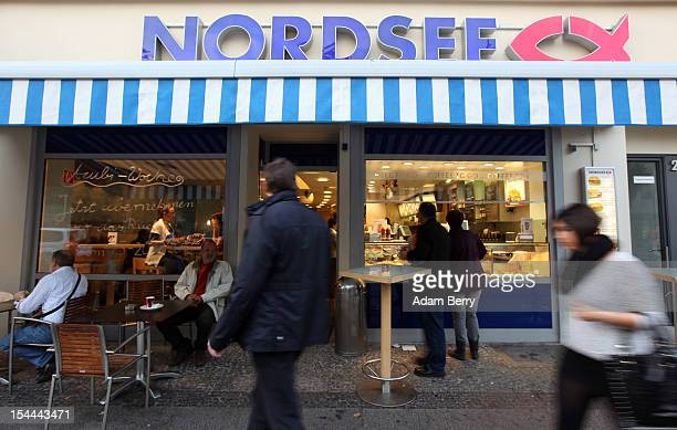 Shoppers pass a Nordsee restaurant on October 20 2012 in Berlin Germany Retail business is the thirdbiggest economic sector in Germany and consumer...