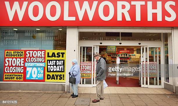 Shoppers pass a Woolworths shop on it's last day of trading on December 27 2008 in New Malden London Almost 200 of Woolworths UK stores will close...
