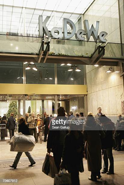 Shoppers pass by a KaDeWe department store at Kurfuerstendamm Avenue November 20 2006 in Berlin Germany Germany has traditionally carefully regulated...